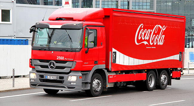 How does Coca Cola's supply chain management adapt around the world?